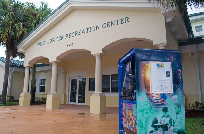 "Give a book, take a book at West Jupiter Recreation Center's ""Little Free Library"""
